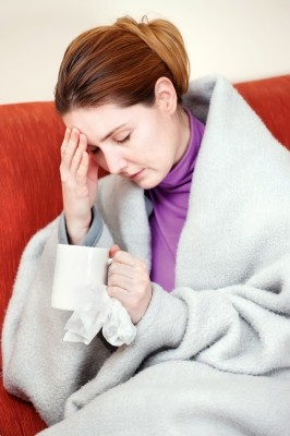 Sick Woman with a cup of tea (Free Digital Photos)